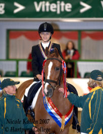Nicole Kullen riding Worleston Billy receiving Silver medal at the 2007 FEI World Para Equestrian Dressage Championships in the UK. Nicole also won a Bronze medal at the same event. Photo Courtesy of Hartpury College.